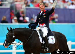 Carl Hester of Great Britain riding Uthopia celebrates after competing in the Team Dressage Grand Prix Special on Day 11 of the London 2012 Olympic Games at Greenwich Park on Aug. 7, 2012