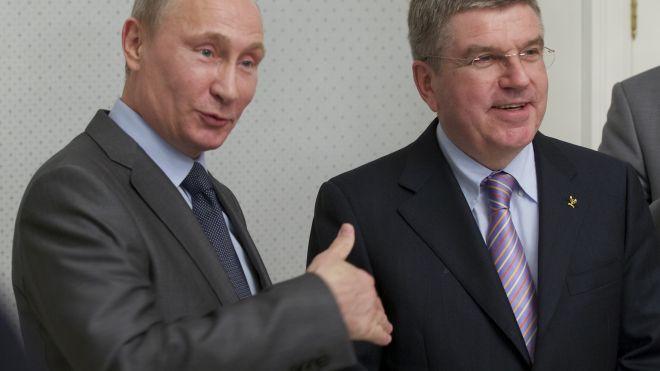 Putin promises gays won't face discrimination during Sochi Olympics